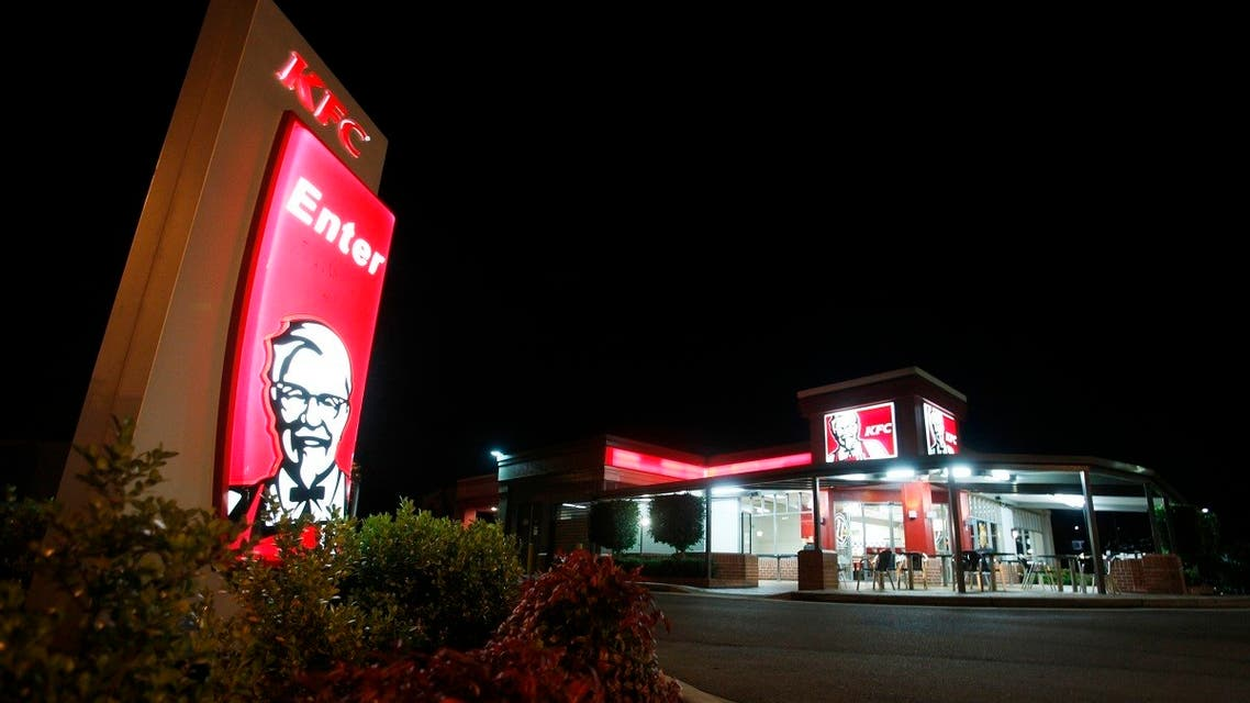An illuminated sign stands at the entrance to a KFC outlet in the Sydney suburb of Villawood April 27, 2012. (File photo: Reuters)