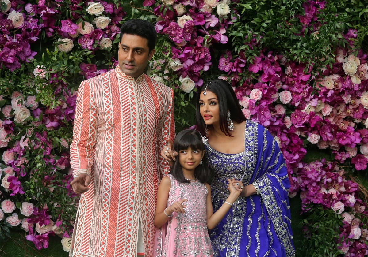 201Actor Abhishek Bachchan, his wife actress Aishwarya Rai and their daughter Aaradhya pose during a photo opportunity at the wedding ceremony in Mumbai, India. (Reuters)9-03-09T162544Z_1695208541_RC136CE3B640_RTRMADP_3_INDIA-AMBANI-MARRIAGE