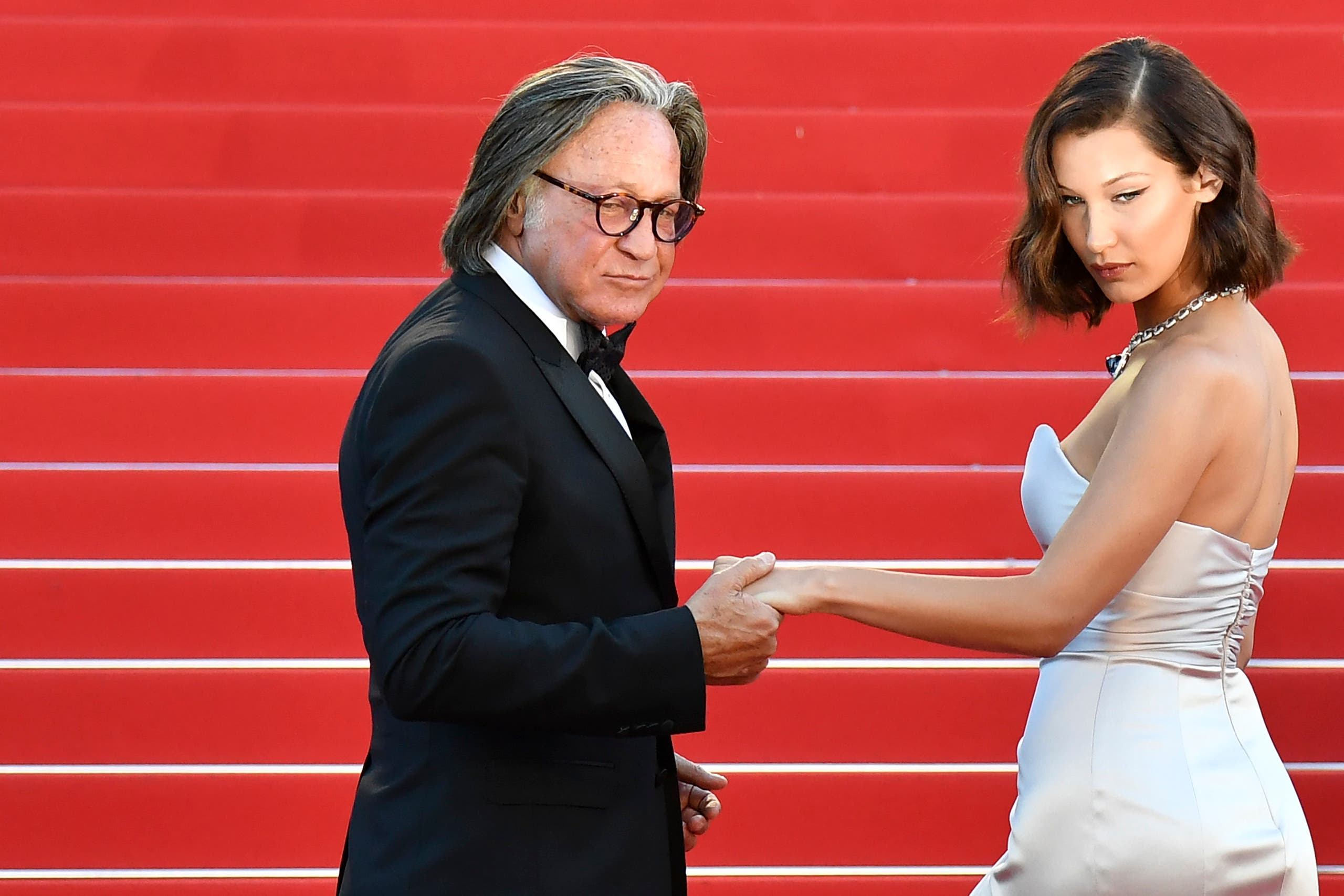 Bella Hadid (R) and her father Mohamed Hadid pose as they arrive on May 17, 2017 for the screening of the film 'Ismael's Ghosts' (Les Fantomes d'Ismael) during the opening ceremony of the 70th edition of the Cannes Film Festival in Cannes, southern France. (File photo: AFP)