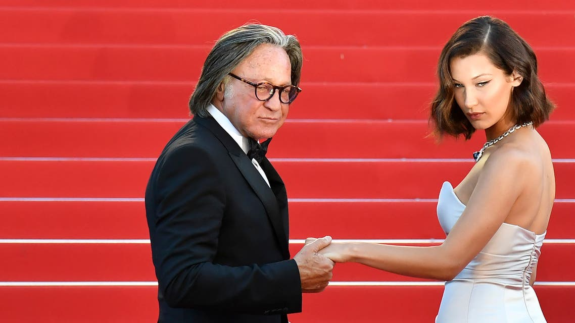 Bella Hadid (R) and her father Mohamed Hadid pose as they arrive on May 17, 2017 for the screening of the film 'Ismael's Ghosts' (Les Fantomes d'Ismael) during the opening ceremony of the 70th edition of the Cannes Film Festival in Cannes, southern France. (AFP)