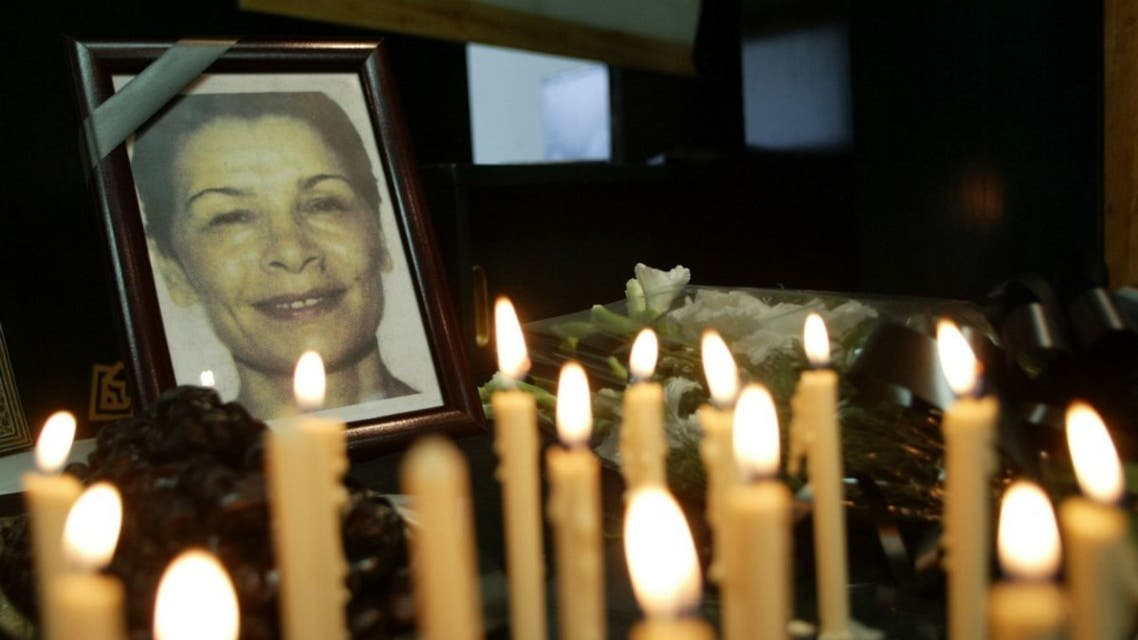 Iranian journalists light candles for the Iranian-Canadian freelance photographer Zahra Kazemi (picture) who died while under arrest in Tehran, during a one-day strike marking 'Journalist Day' 08 August 2003. (AFP)