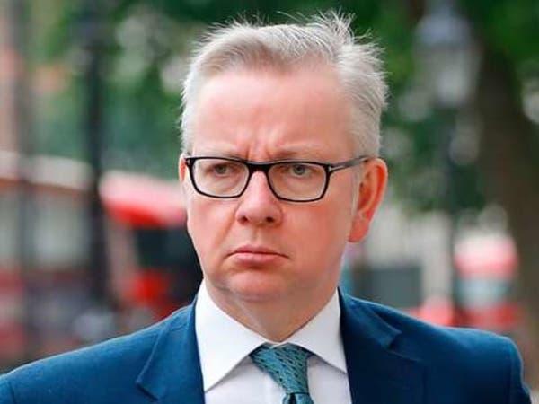 وزير بريطاني: لا حاجة لارتداء الكمامات في المتاجر