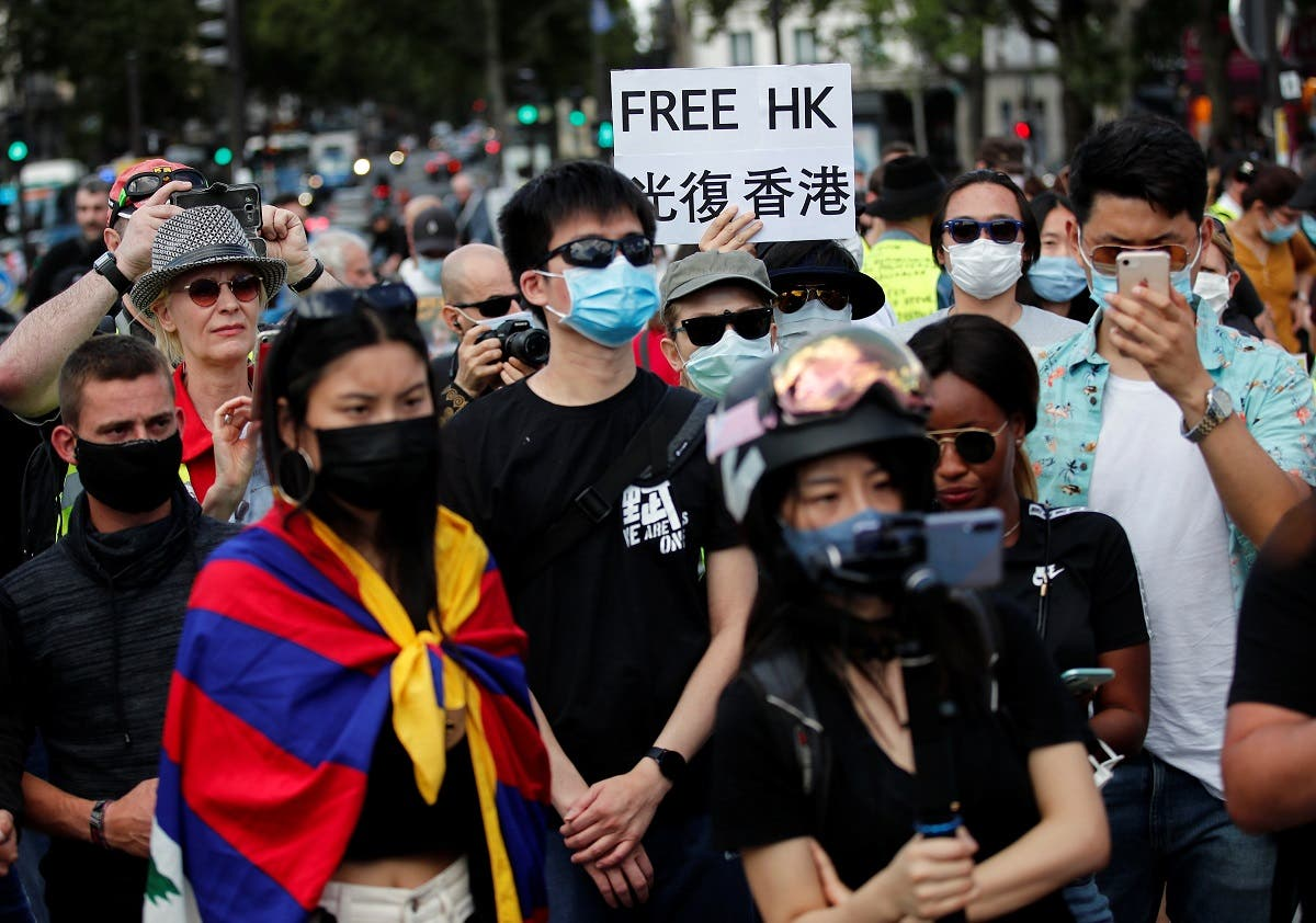 People demonstrate in support of Hong Kong protesters opposed to China's national security law and to urge French authorities to take a stronger stand against Chinese policy, in Paris, on July 11, 2020. (Reuters)