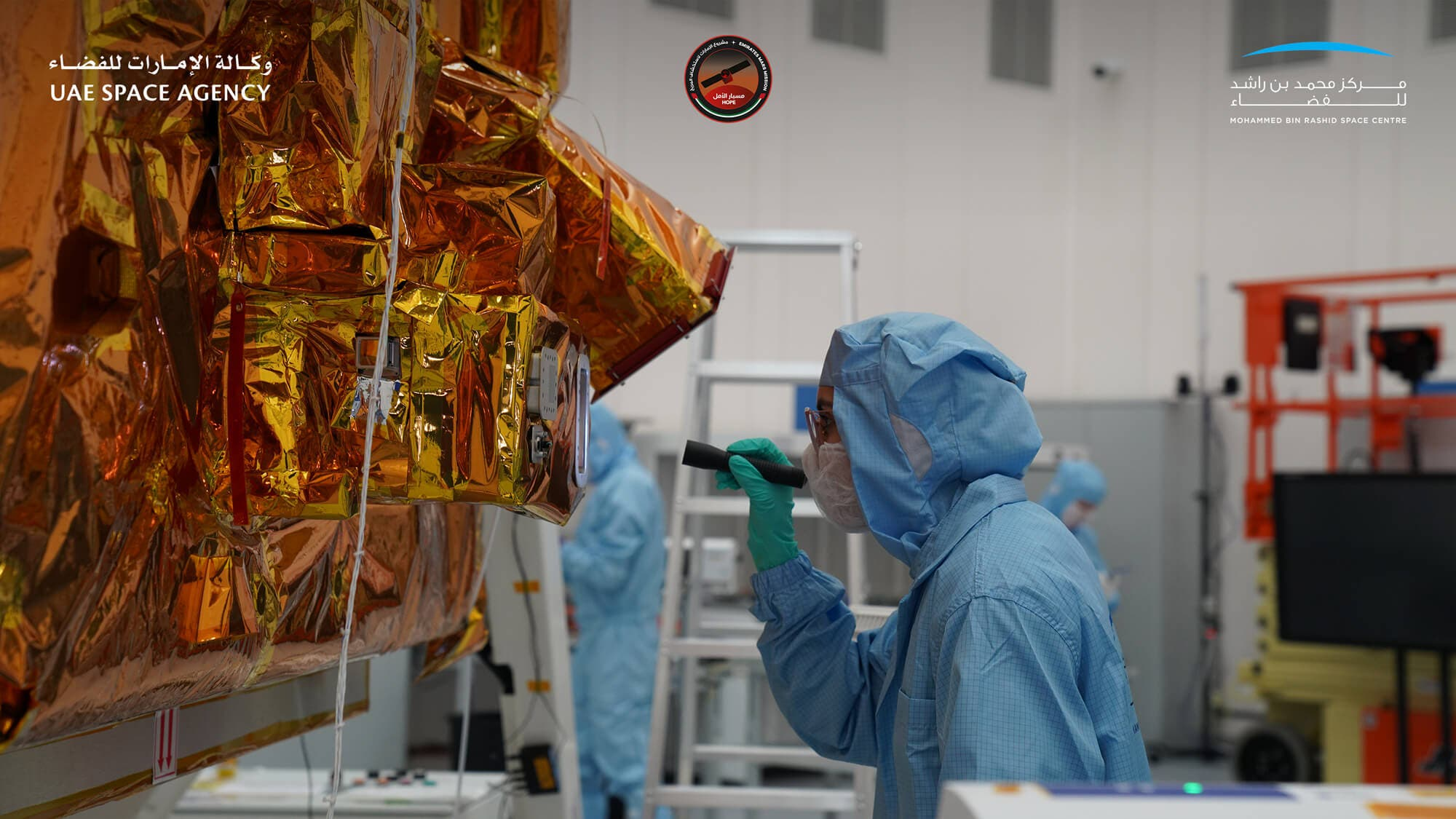 A scientist inspects the Emirates Mars Mission Hope Probe. (UAE Space Agency and Mohammed bin Rashid Space Centre)