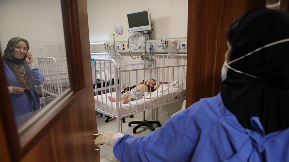 A child lies on a bed at Mofid children's hospital, where children suspected to be infected with the coronavirus disease (COVID-19) are treated, in Tehran, Iran, July 8, 2020. WANA (West Asia News Agency) Abdollah Heidari via REUTERS ATTENTION EDITORS - THIS PICTURE WAS PROVIDED BY A THIRD PARTY