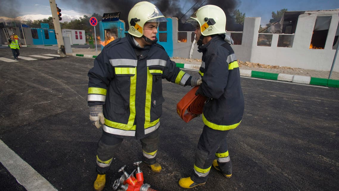 Fire fighters take part in a preparation for disaster manoeuvre in north eastern Tehran, Iran. (File photo: Reuters)
