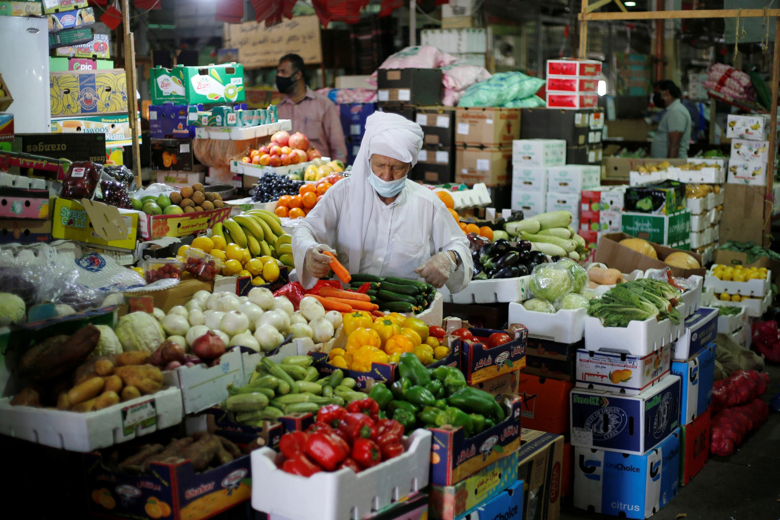 A Bahraini man, wearing a face mask, following the outbreak of the coronavirus disease (COVID-19), shops at a vegetables stand, in Central Market, in Manama, Bahrain, June 13, 2020. (Reuters)