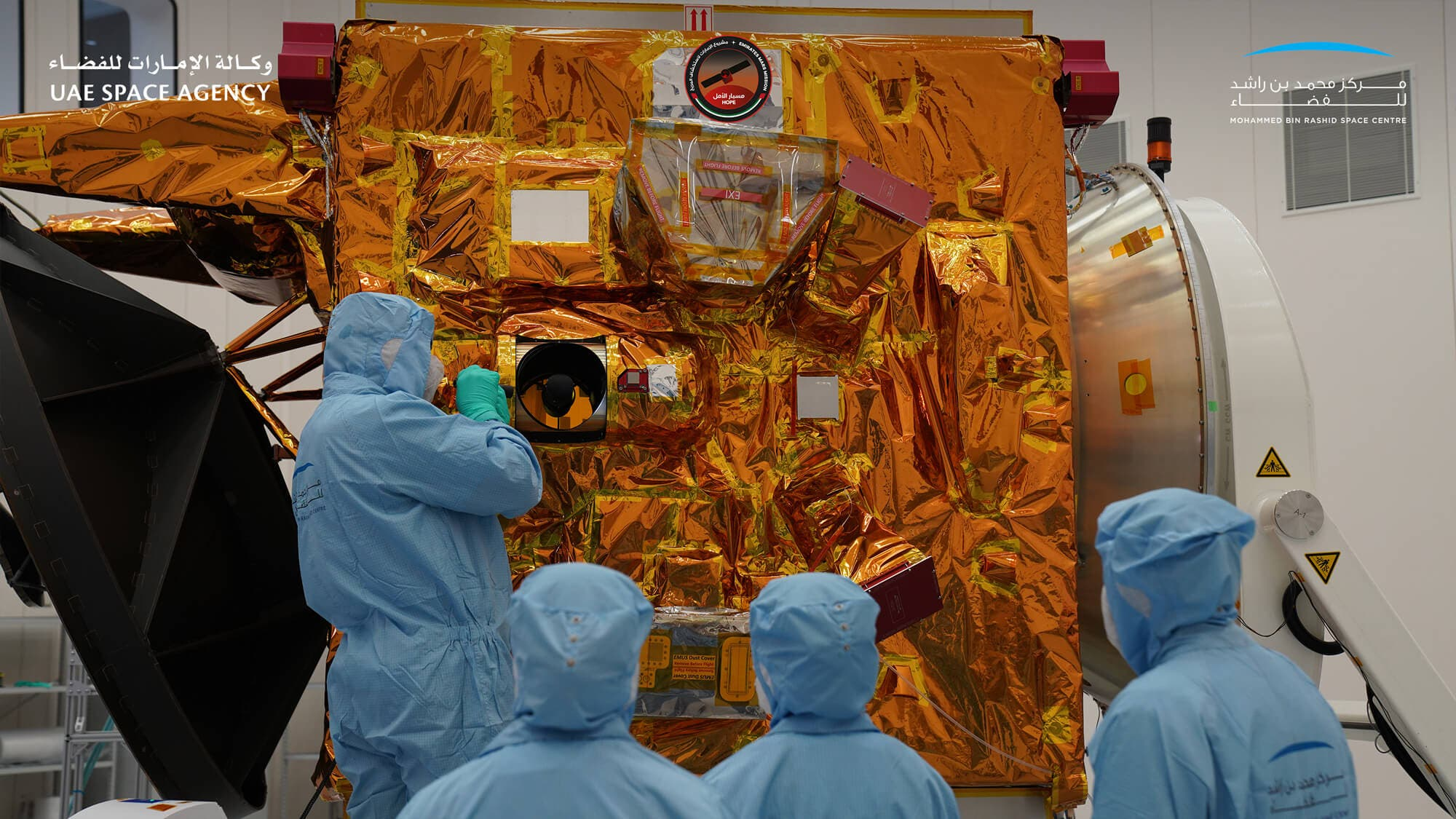 Scientists inspect the Emirates Mars Mission Hope Probe. (UAE Space Agency and Mohammed bin Rashid Space Centre)