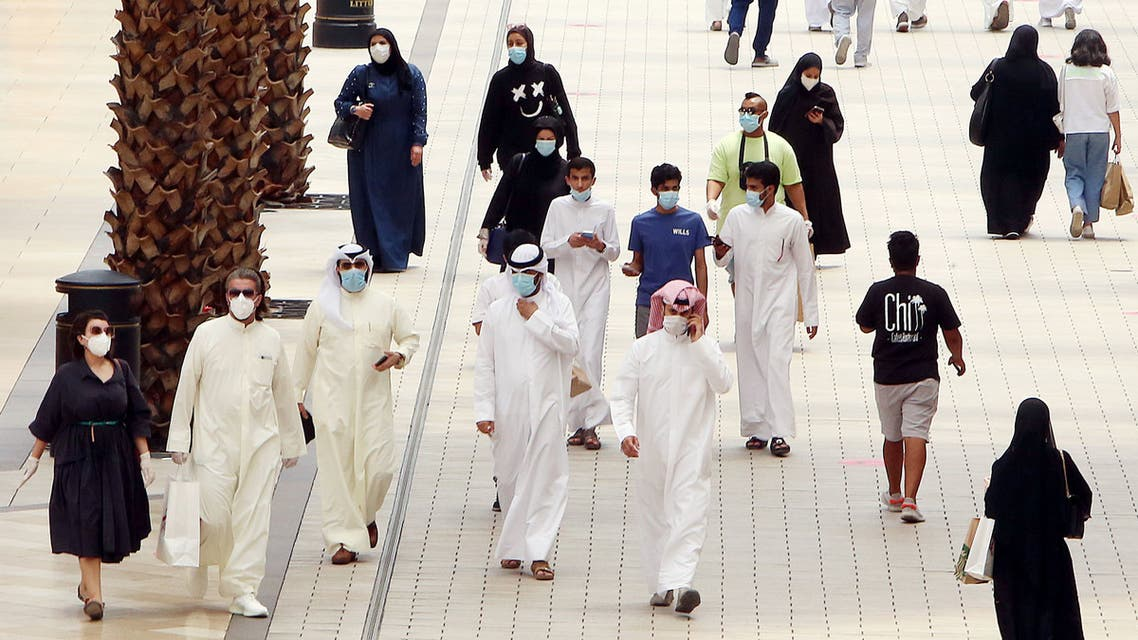 Kuwaitis wearing face masks walk inside the re-opened Avenues Mall, the country's largest shopping centre, on June 30, 2020 in Kuwait City after almost a four-months shutdown to prevent the spread of the coronavirus Covid-19 in the country.