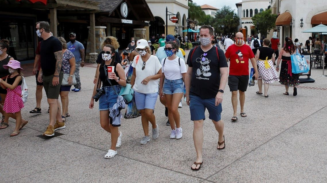 Disney Springs shoppers wear face masks and Disney-themed clothing while Walt Disney World conducts a phased reopening from coronavirus disease (COVID-19) restrictions in Lake Buena Vista, Florida. (Reuters)