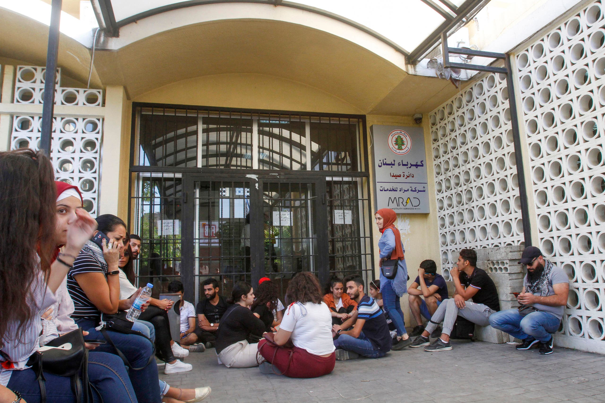 Lebanese demonstrators block the entrance of the electricity company in the southern city of Sidon (Saida) on November 12, 2019, during ongoing anti-government demonstrations. (AFP)