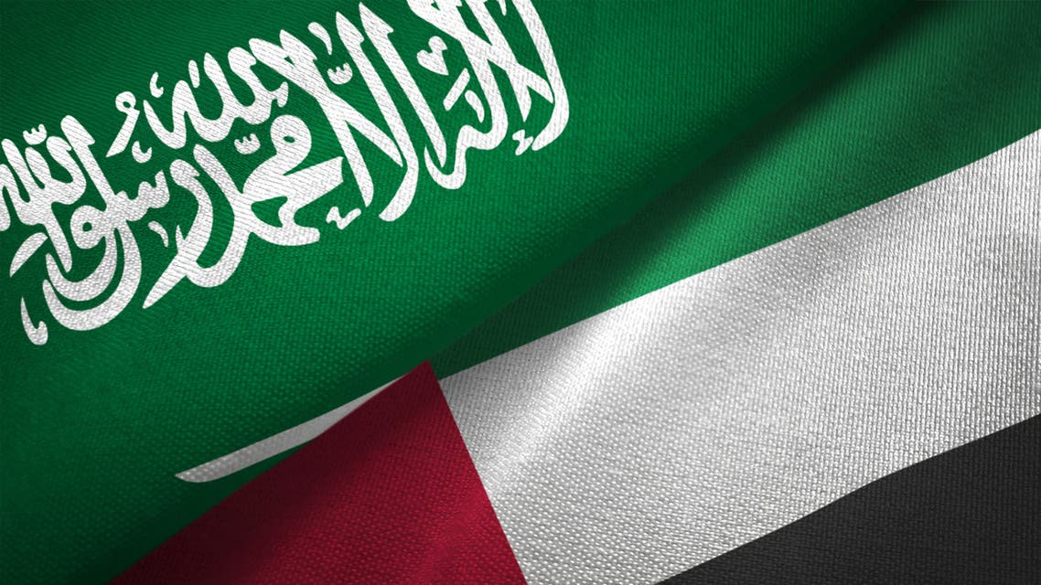 United Arab Emirates and Saudi Arabia two flags together realations textile cloth fabric texture stock photo