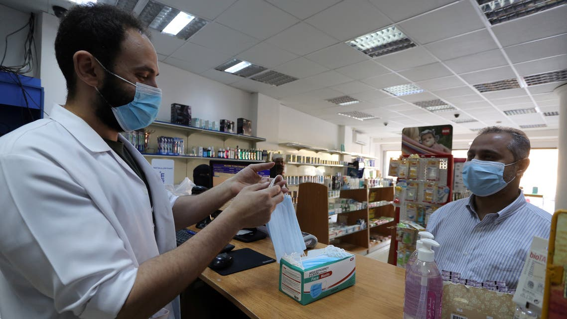 A man wearing a protective mask, buys masks from a pharmacy, after the government lifted coronavirus disease (COVID-19) lockdown restrictions, in Riyadh, Saudi Arabia July 5, 2020. REUTERS/Ahmed Yosri