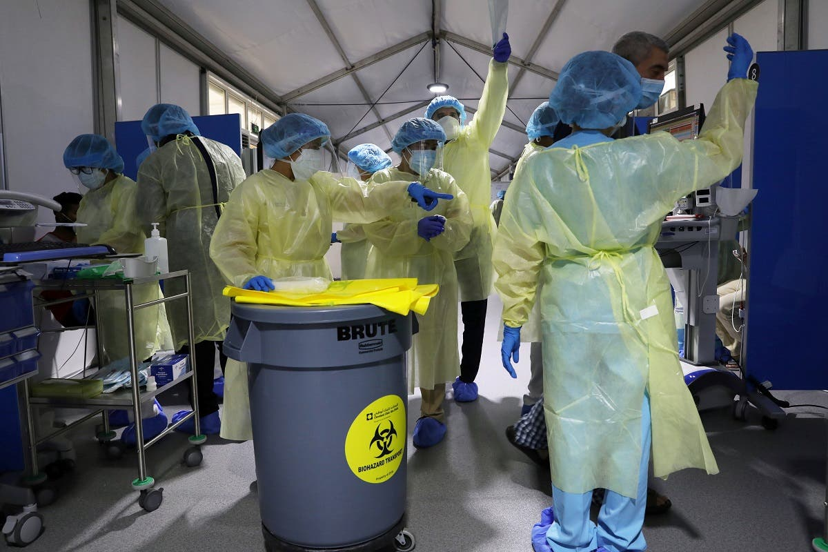 Members of medical staff wearing protective equipment work during testing, amid the coronavirus disease (COVID-19) outbreak, at the Cleveland Clinic hospital in Abu Dhabi. (Reuters)