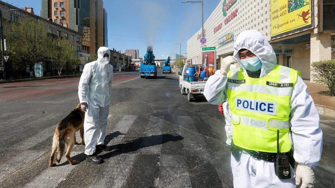 Staff members and police officers wear hazmat suits as they take part in a drill to prepare for the COVID-19 coronavirus in Ulaanbaatar, the capital of Mongolia on May 7, 2020. (AFP)