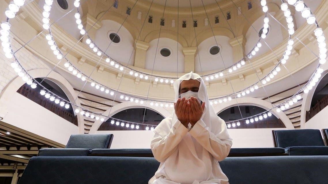 A Saudi man wearing a protective face mask performs the Al-Fajr prayer inside the Al-Rajhi Mosque in Riyadh. (Reuters)