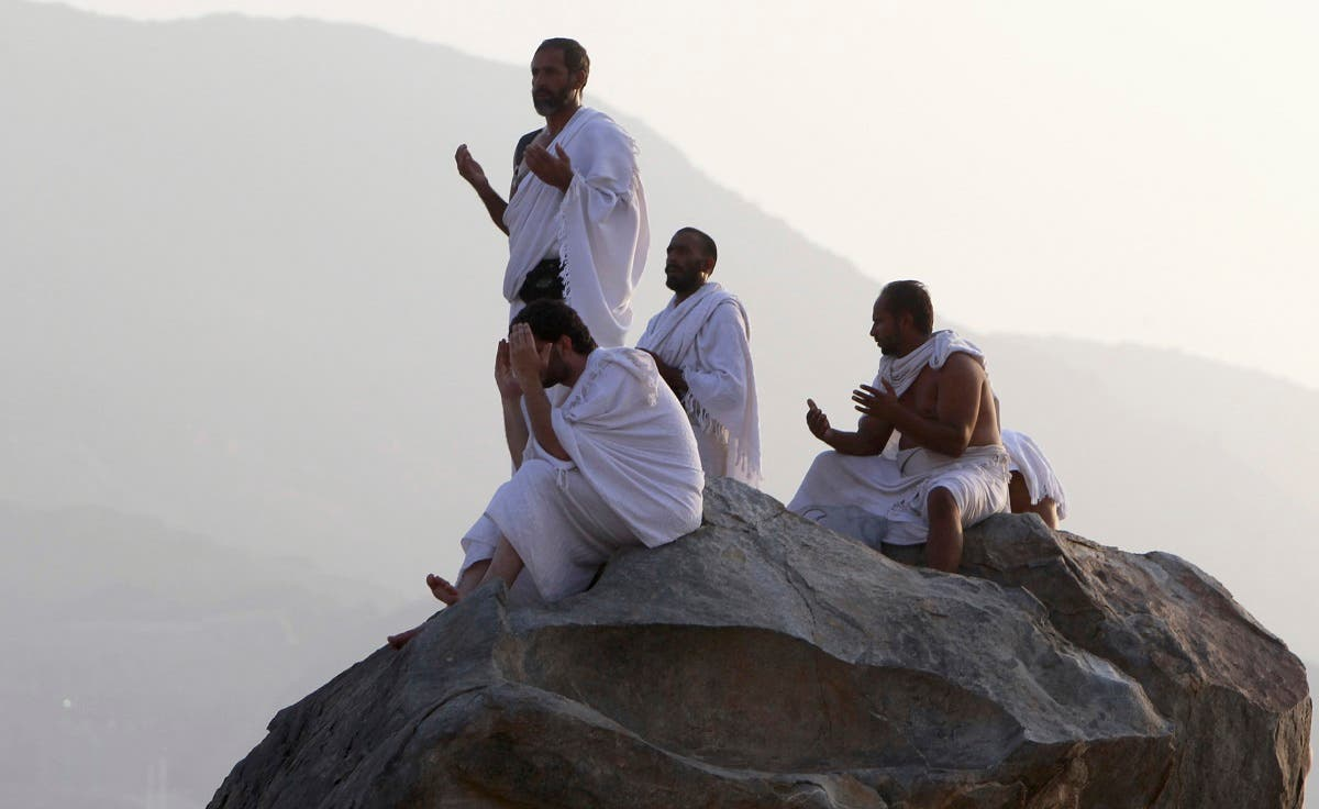 Muslim pilgrims pray on Mount Mercy on the plains of Arafat in the early morning during the peak of the annual Hajj pilgrimage, near the holy city of Mecca. (Reuters)
