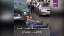 Watch: Angry Iranian lies in front of car in Mashhad, blames regime for hardship