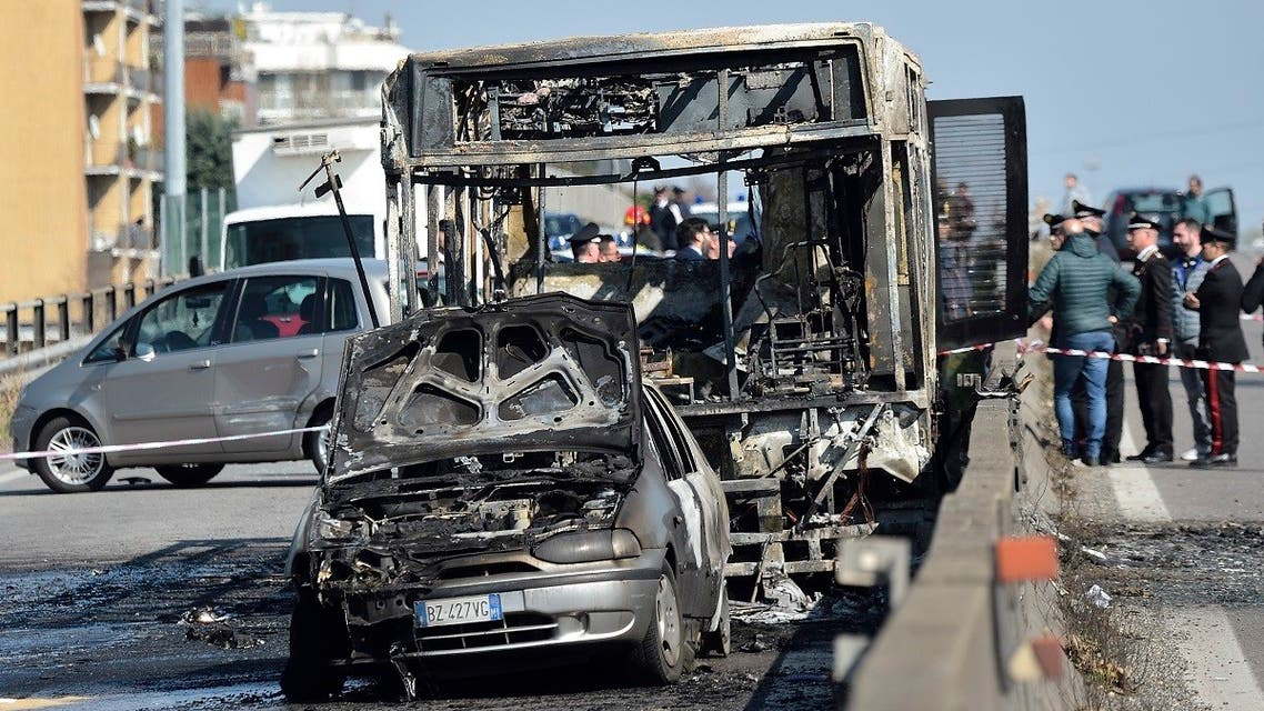 The wreckage of a school bus that was transporting some 50 children is pictured on March 20, 2019 after it was torched by the bus' driver, in San Donato Milanese, southeast of Milan. (AFP)