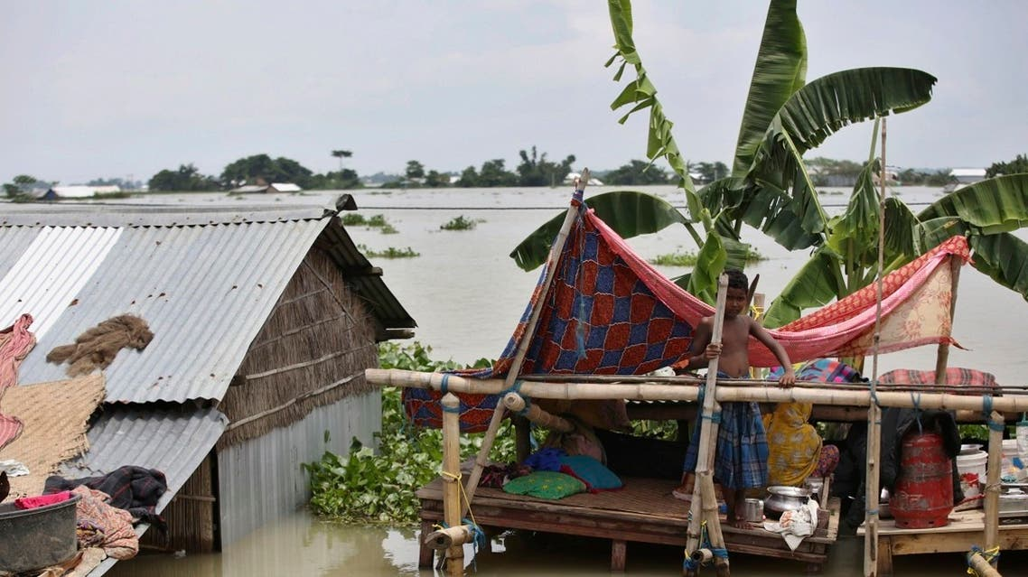 AP_20196An Indian flood affected boy stands on a makeshift platform near his partially submerged house in Gagolmari village, Morigaon district, Assam, India, Tuesday, July 14, 2020.  (AP)504992300