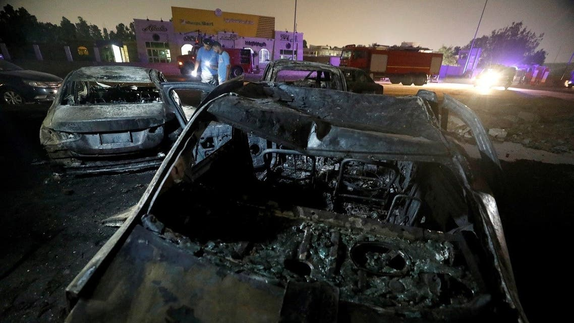 Burned vehicles are seen following a fire that broke out in Egypt's Shuqair-Mostorod crude oil pipeline, at the beginning of Cairo-Ismailia road, Egypt July 14, 2020. (Reuters)