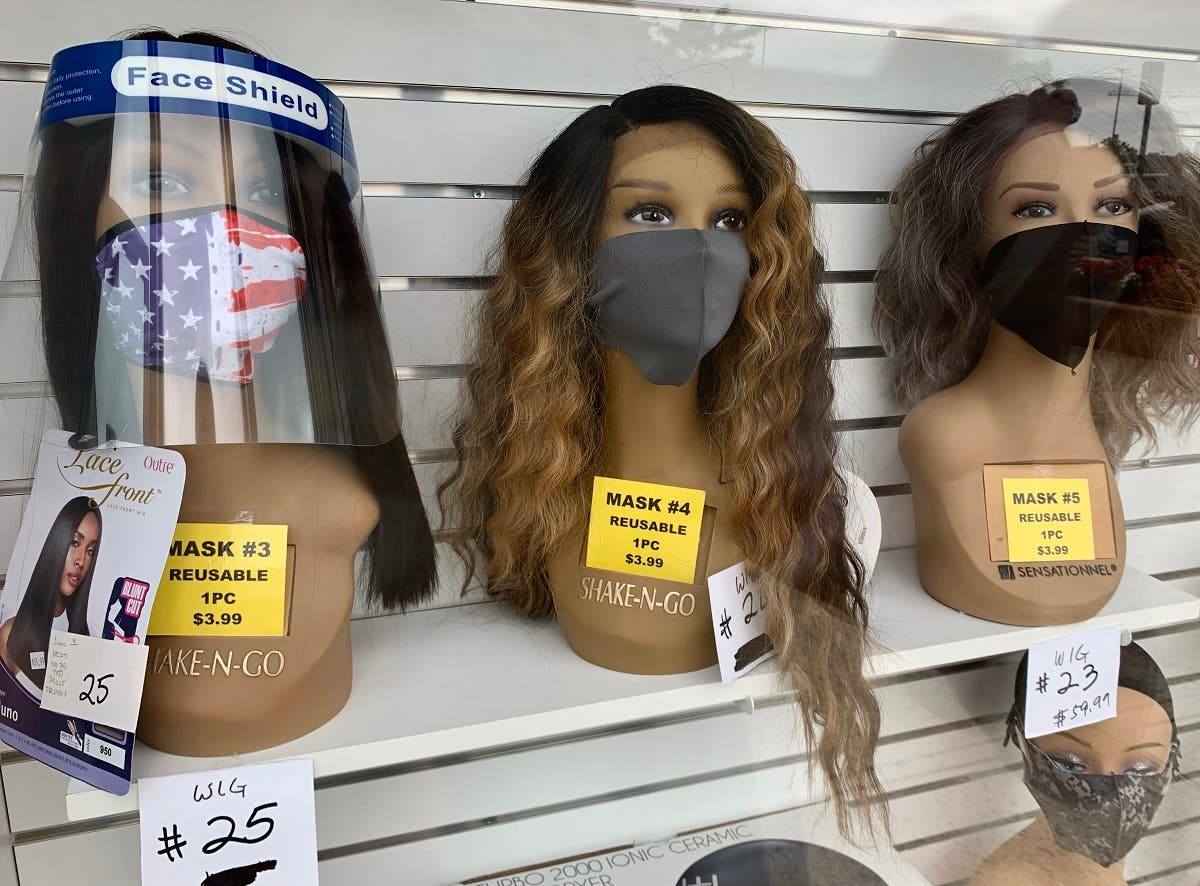 Designer face masks in the display window of a beauty and wig salon are for sale in Washington, DC on June 17, 2020. (AFP)