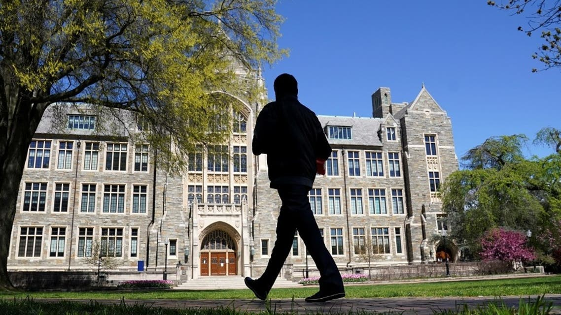 A man walks at an empty campus green at Georgetown University, closed weeks ago due to coronavirus. (File Photo: Reuters)