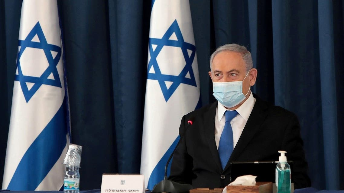 Israeli Prime Minister Netanyahu wears a protective mask, amid the spread of the coronavirus disease (COVID-19), as he holds a weekly cabinet meeting at the Foreign Ministry in Jerusalem, July 5, 2020. (Reuters)