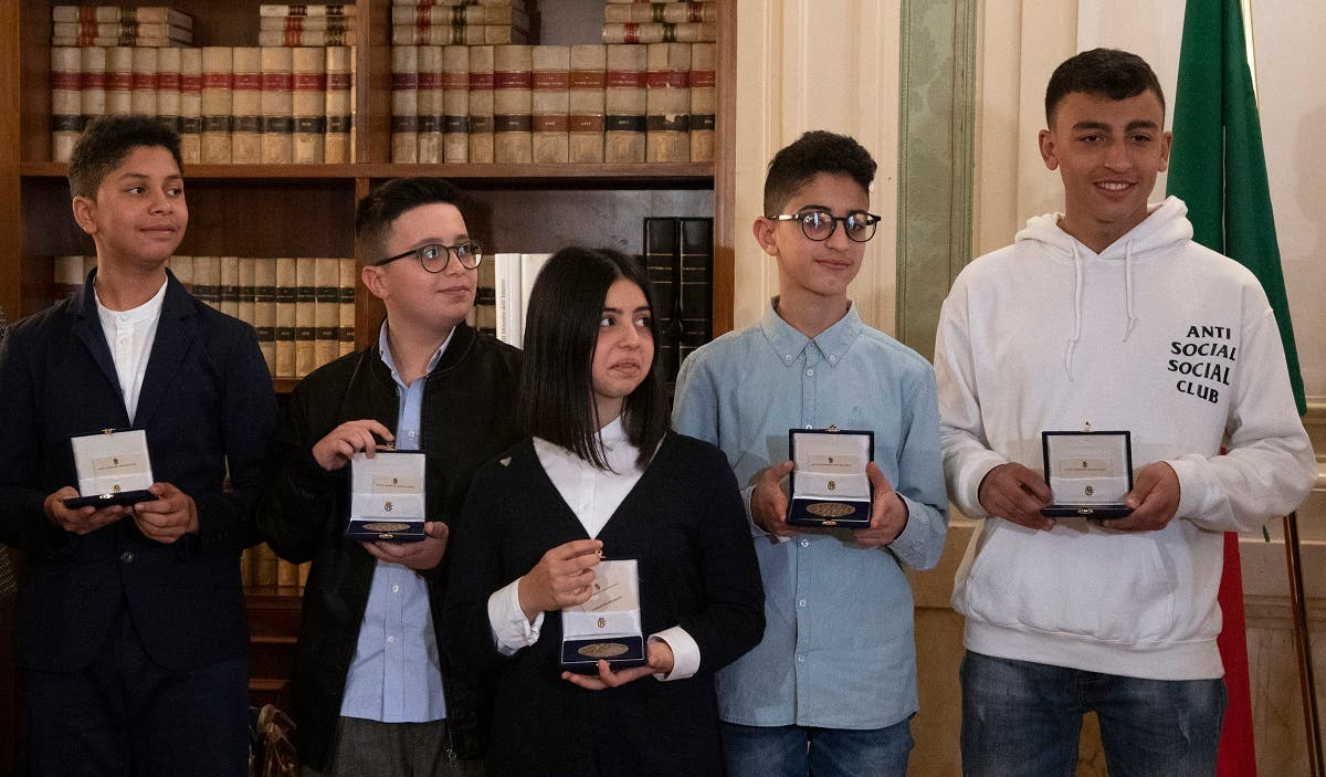 (FromL) Niccolo, Fabio, Aurora, Adam and Rami, the five children who helped to save other children during the March 20 Milan bus attack, pose with their medals handovered by Italian Deputy Premier and Interior Minister Salvini in Rome, March 27, 2019. (AFP)