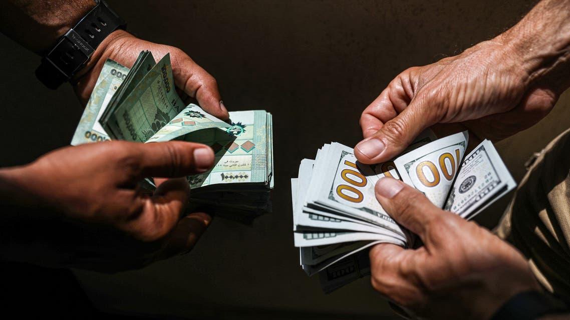 الدولار والأزمة الاقتصادية في لبنان(أرشيفية- فرانس برس)