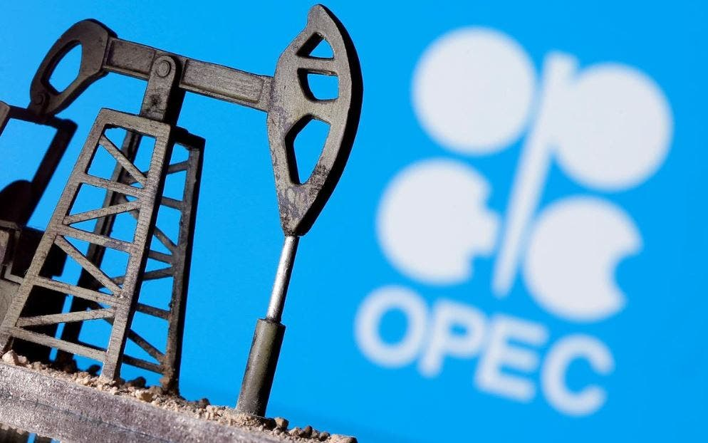 A 3D printed oil pump jack is seen in front of displayed Opec logo in this illustration picture, April 14, 2020. (Reuters)