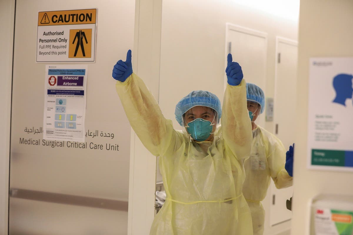 A member of medical staff wearing protective equipment gestures while entering the intensive care unit (ICU), amid the coronavirus disease (COVID-19) outbreak, at the Cleveland Clinic hospital in Abu Dhabi. (Reuters)