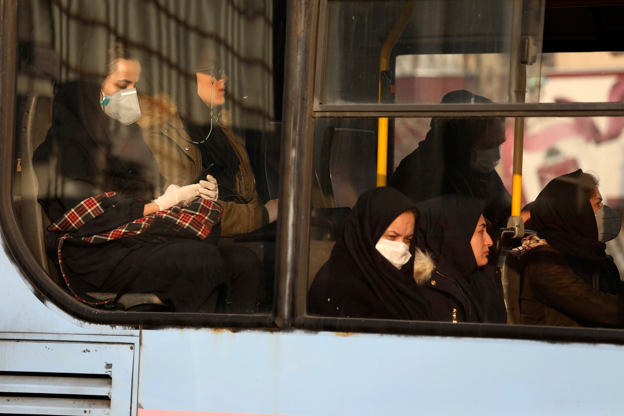 Woman, wearing face masks, on a public bus in a street in Tehran on Feb. 29, 2020. (File photo: AP)