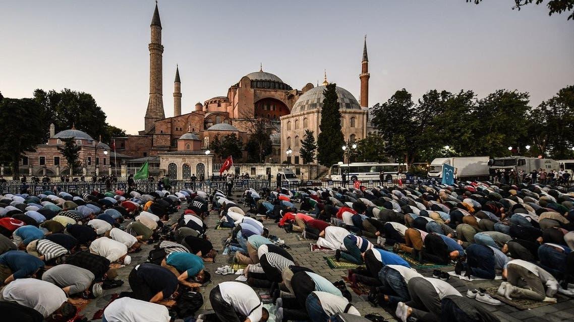 Muslims pray outside the Hagia Sophia. (AFP)
