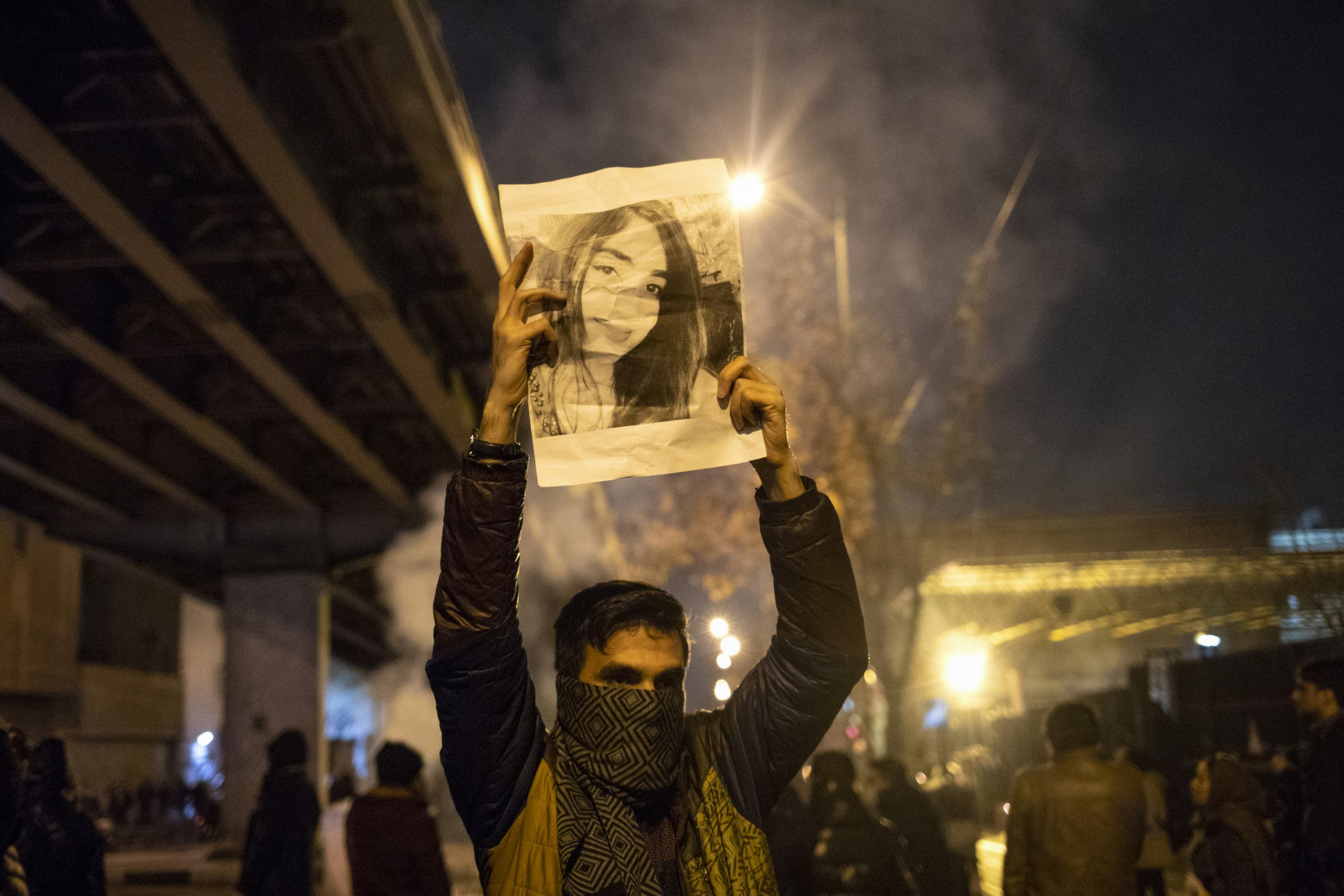 An Iranian man holds a picture of a victim of the Ukrainian plane downing during a demonstration in Tehran on January 11, 2020. (File photo: AP)