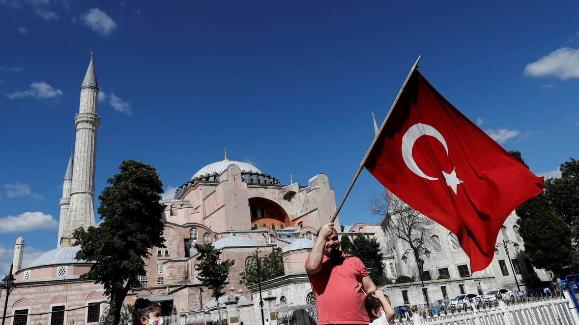 A man waves a Turkish Flag in front of the Hagia Sophia or Ayasofya, after a court decision that paves the way for it to be converted from a museum back into a mosque, in Istanbul, Turkey, July 10, 2020. (Reuters)