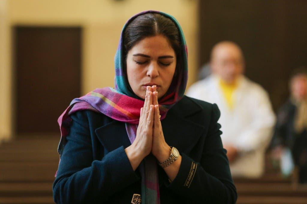 An Iranian Christian prays during mass at the Saint Sarkis Armenian Cathedral in Tehran on January 1, 2020. (File photo: AFP)