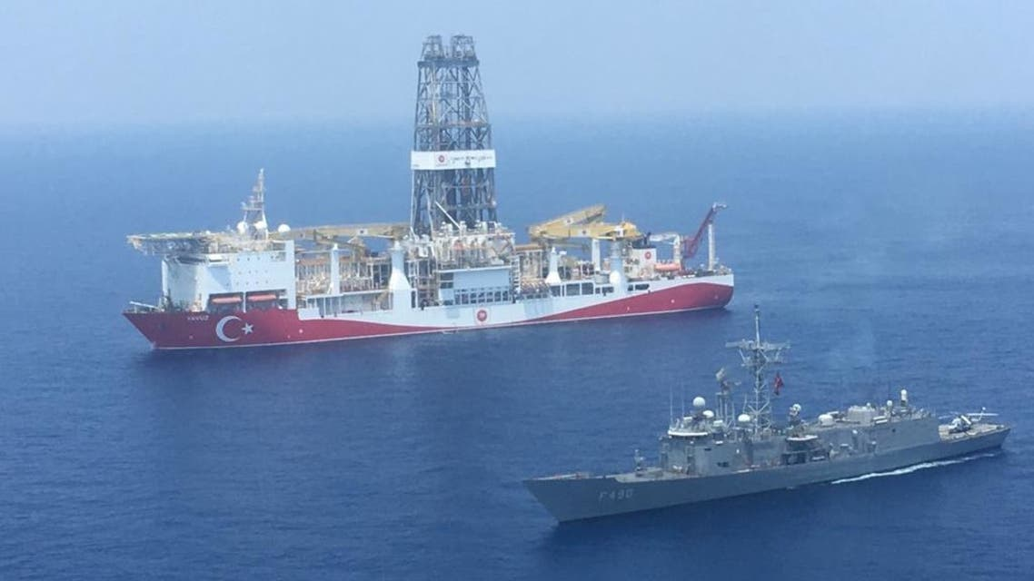 A handout photograph taken and relased by the Turkish Defence Ministery on July 9,2019 shows a Turkish Navy warship patroling next to Turkey's drilling ship Fatih dispatched towards the eastern Mediterranean near Cyprus. Turkey will increase its activities off Cyprus after the EU approved measures to punish Ankara for drilling operations in the eastern Mediterranean, the Turkish foreign minister said on July 16, 2019.