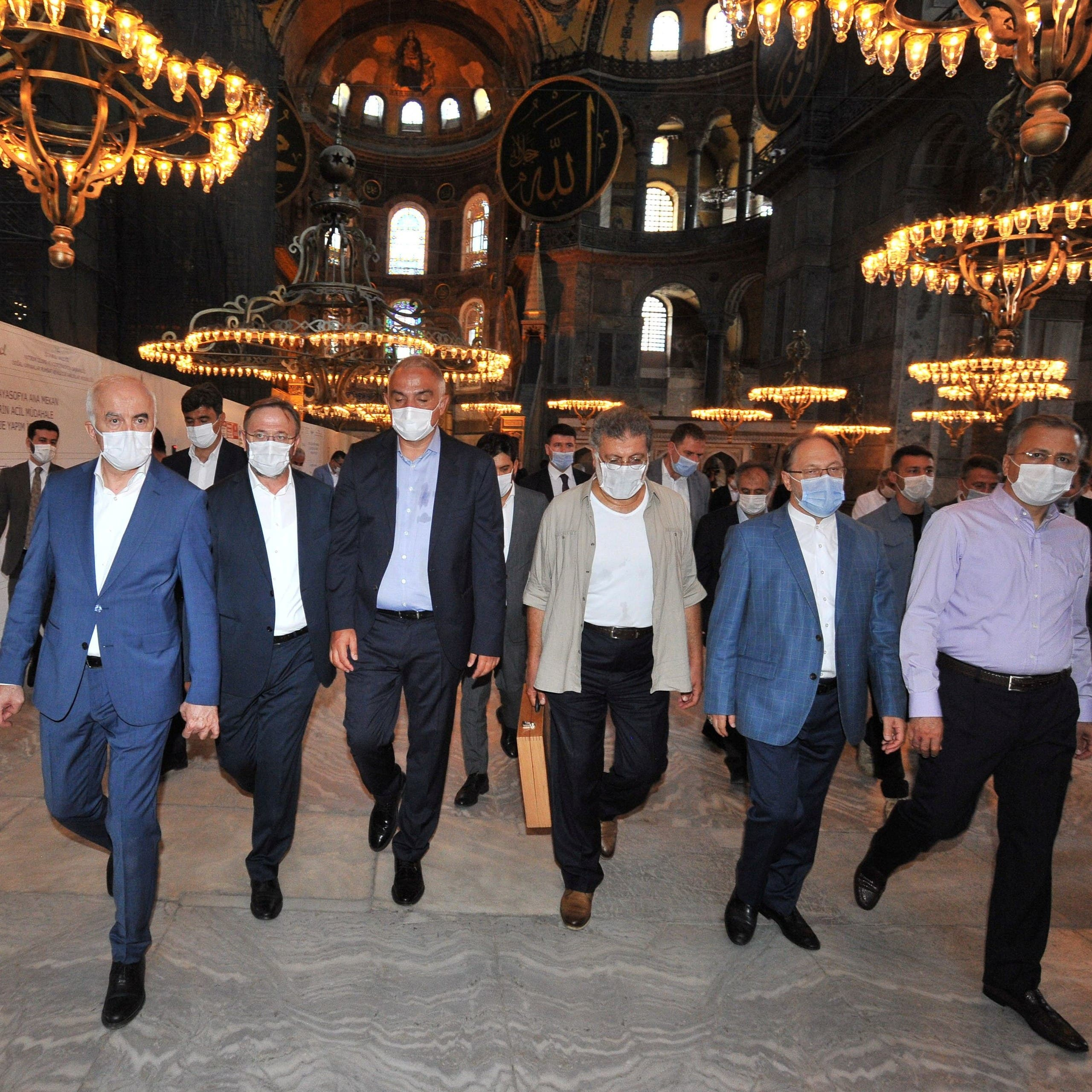 Turkey's Culture and Tourism Minister Mehmet Nuri Ersoy, accompanied by head of Turkey's Religious Affairs Directorate Ali Erbas, visits the Hagia Sophia or Ayasofya-i Kebir Camii in Istanbul, Turkey, July 12, 2020. (Turkish Culture and Tourism Ministry/Handout via Reuters)