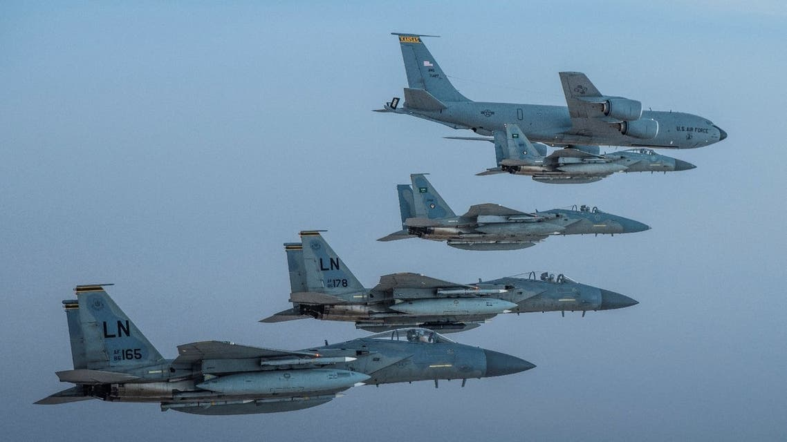 Royal Saudi Air Force F-15C Eagles fly in formation with US Air Force F-15Cs in an undisclosed location, June 2, 2019. (US Navy via Reuters)
