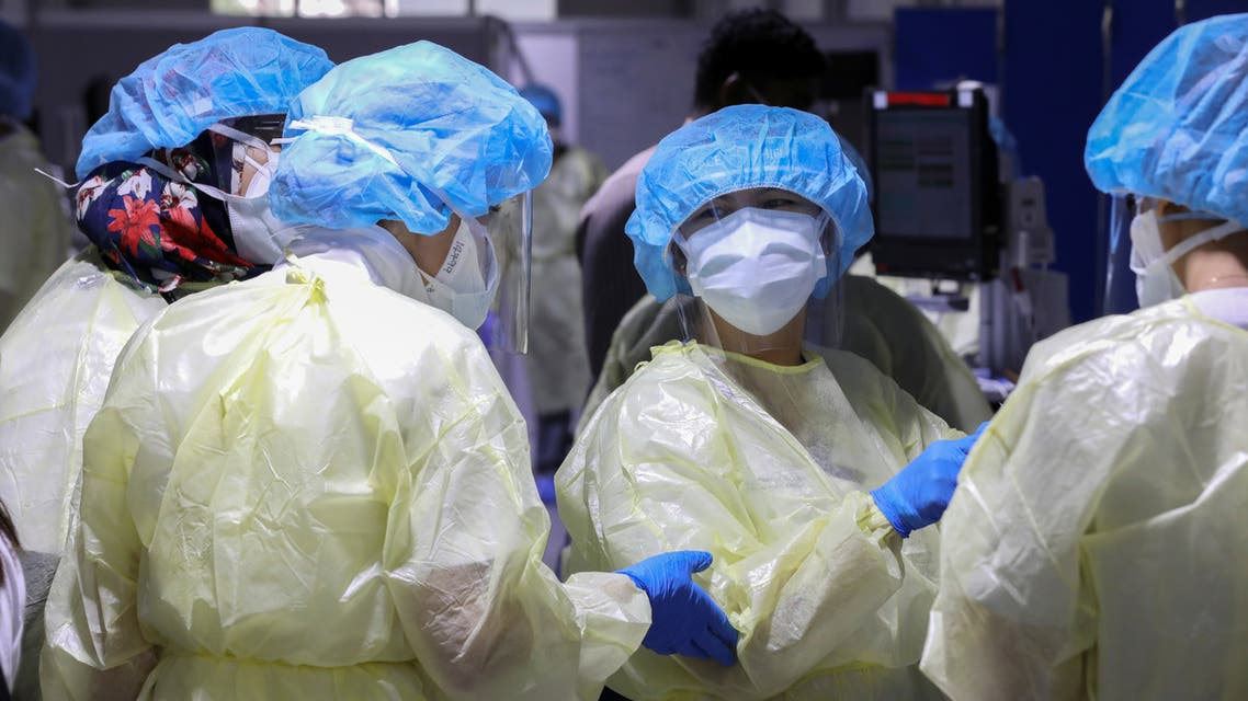 A member of medical staff wearing protective equipment swabs a man during testing, amid the coronavirus disease (COVID-19) outbreak, at the Cleveland Clinic hospital in Abu Dhabi, United Arab Emirates, April 20, 2020. REUTERS/Christopher Pike