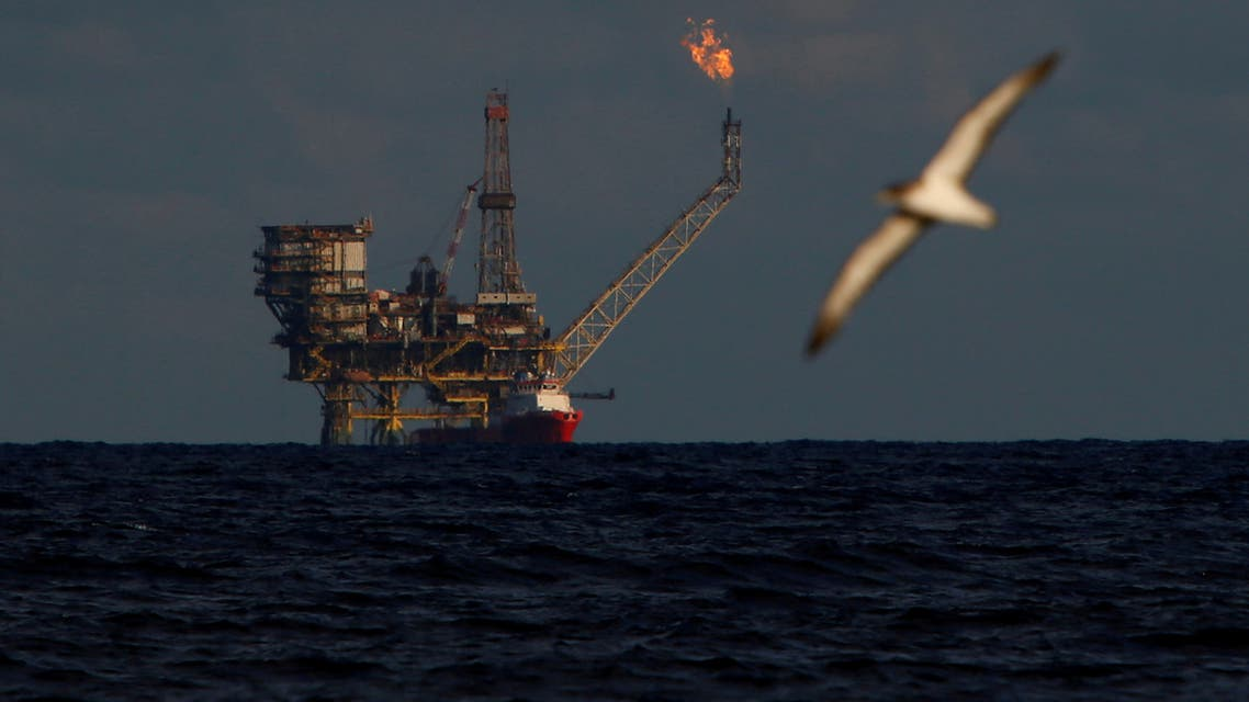 FILE PHOTO: A seagull flies in front of an oil platform in the Bouri Oilfield some 70 nautical miles north of the coast of Libya, October 5, 2017. REUTERS/Darrin Zammit Lupi/File Photo
