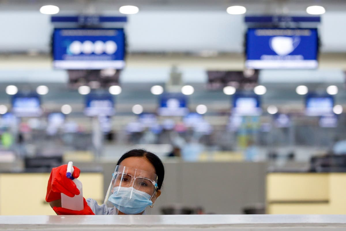 A worker wearing personal protective equipment sprays disinfectant on a surface to prevent the spread of coronavirus disease (COVID-19), in Ninoy Aquino International Airport in Pasay City, Metro Manila, Philippines. (Reuters)