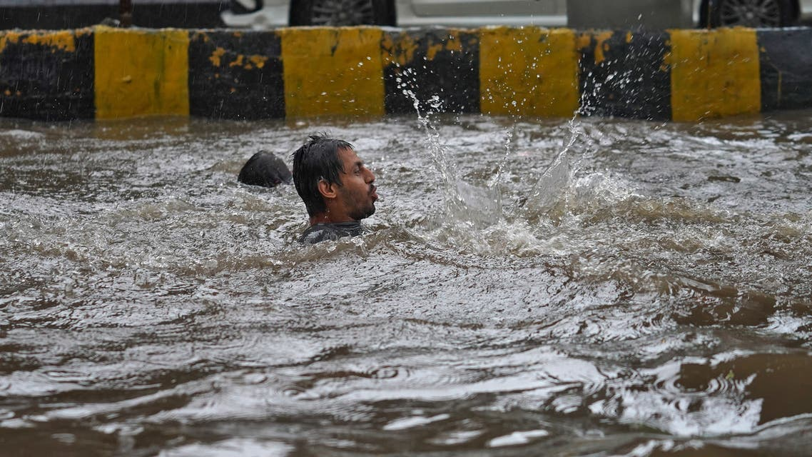 A man plays in a flooded road during heavy rains in Mumbai. (Reuters)