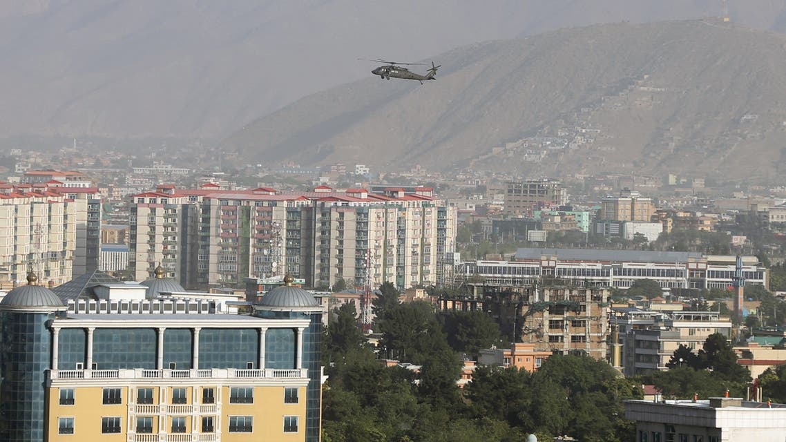 A NATO helicopter flies over the city of Kabul, Afghanistan June 29. 2020. REUTERS/Omar Sobhani