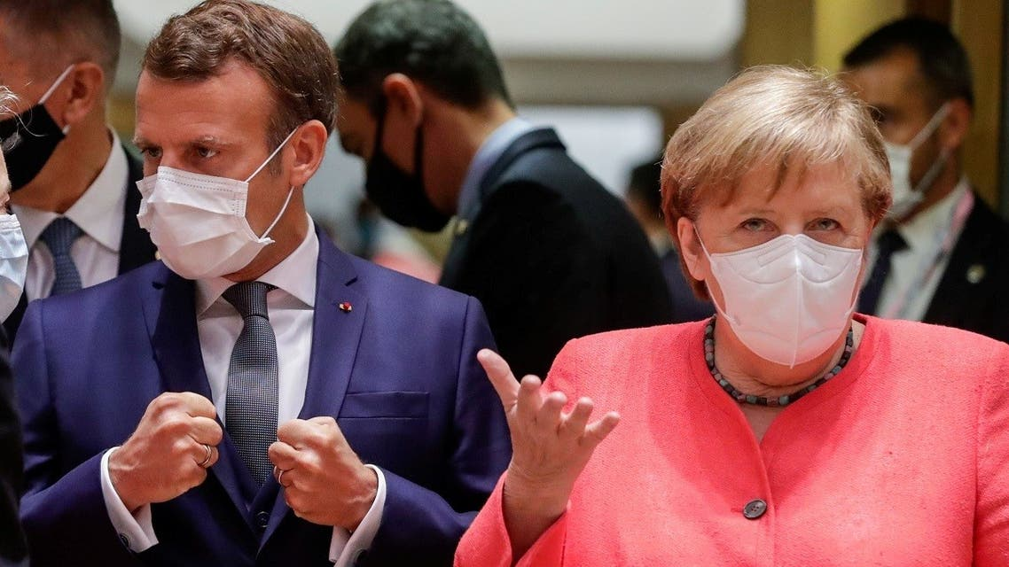 German Chancellor Angela Merkel and French President Emmanuel Macron are seen at the start of the first face-to-face EU summit since the coronavirus outbreak, in Brussels, Belgium, on  July 17, 2020. (Reuters)