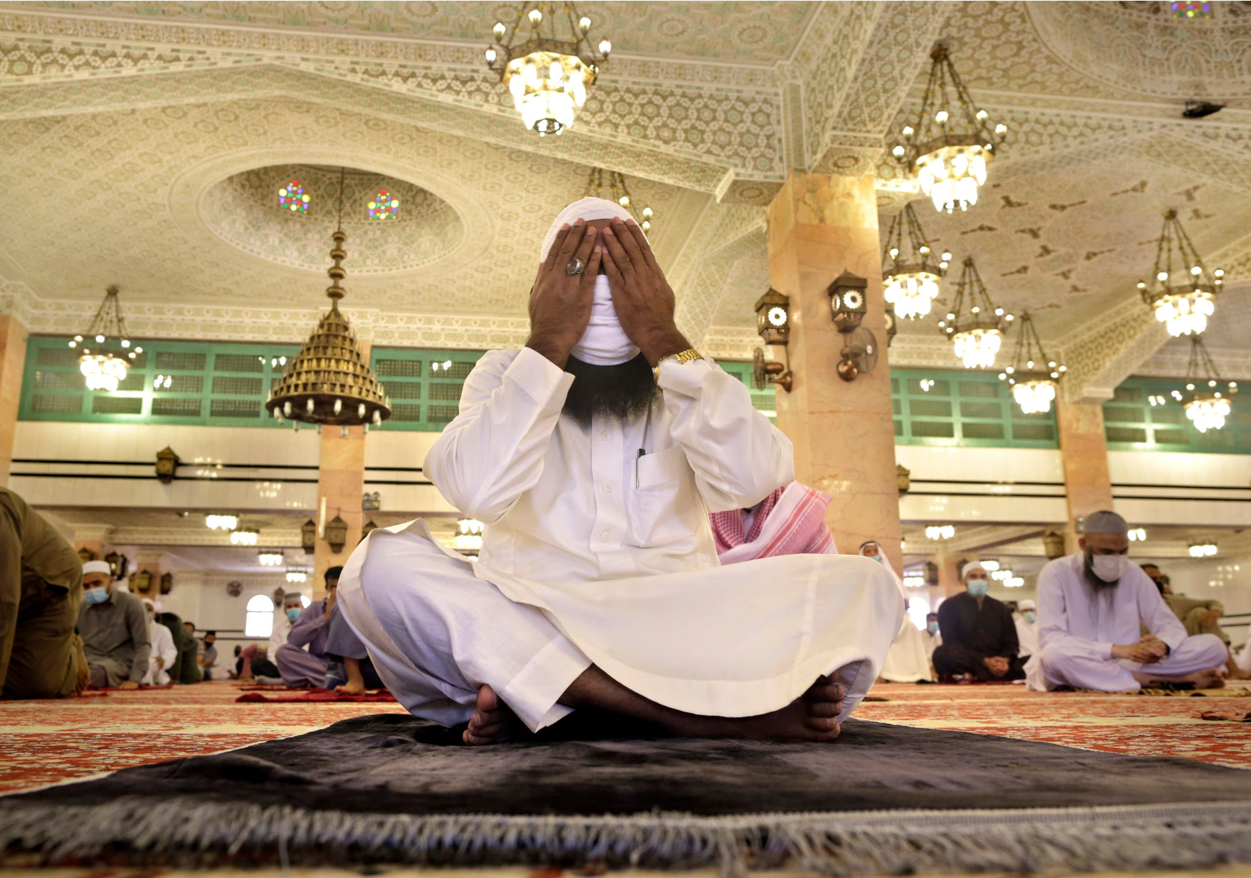 A Saudi worshipper wearing a face mask to prevent the spread of COVID-19, prays at the al-Mirabi Mosque in Jiddah, Saudi Arabia, Friday, July 10, 2020. (AP Photo/Amr Nabil)