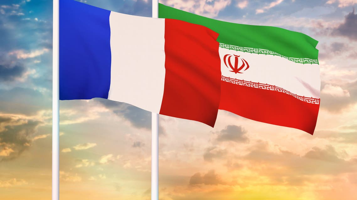 Iran and France two flags together realations textile cloth fabric texture stock photo