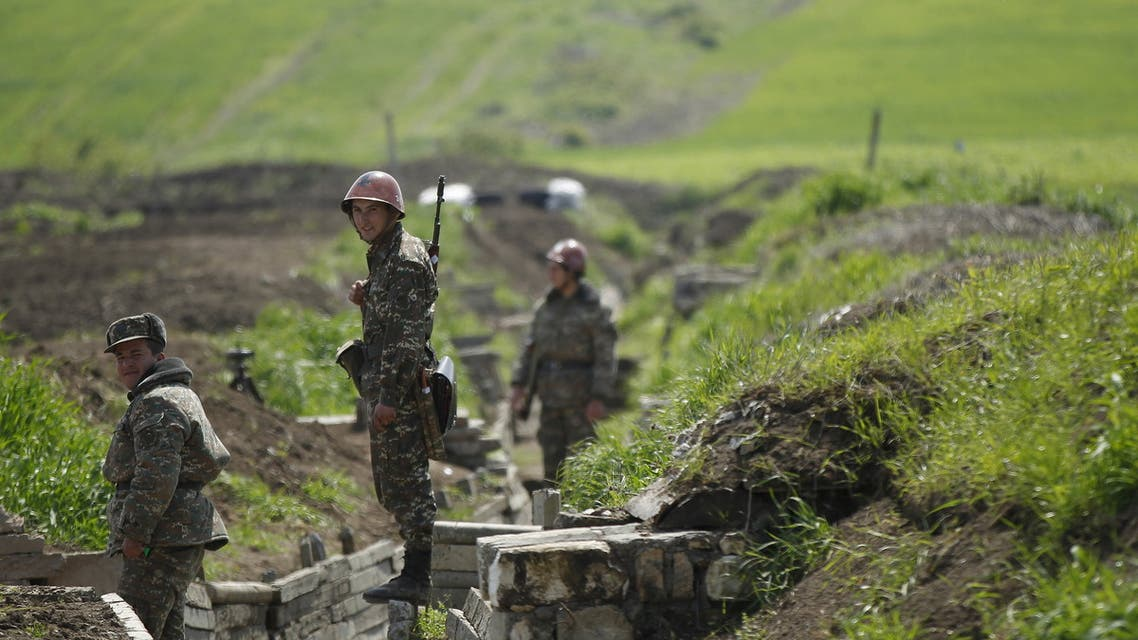 Ethnic Armenian soldiers stand in a trench at their position near Nagorno-Karabakh's town of Martuni, April 8, 2016. REUTERS/Staff