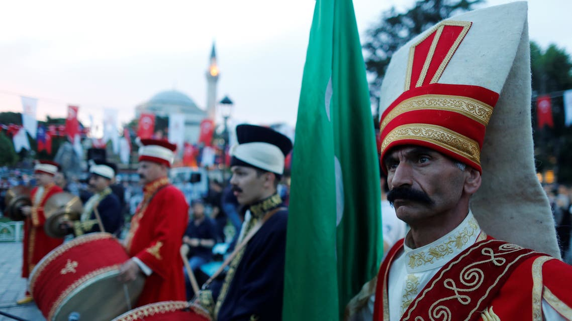 Members of traditional Ottoman band Mehter perform before breaking fast at Sultanahmet Square on the first day of the holy fasting month of Ramadan in Istanbul, Turkey May 16, 2018. (Reuters)
